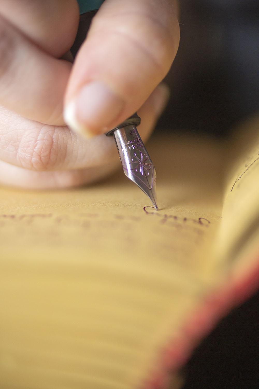 fountain pen writing in journal